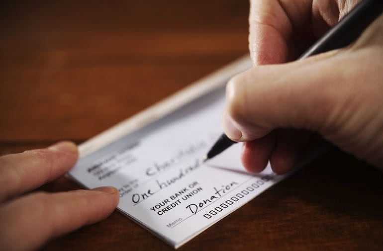 Why writing a cheque to a charity is not enough?